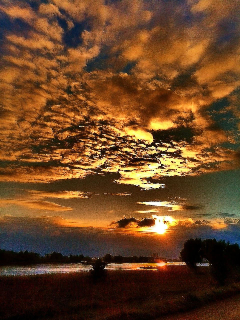 sunset, beauty in nature, nature, scenics, sky, tranquil scene, tranquility, cloud - sky, dramatic sky, majestic, orange color, silhouette, no people, idyllic, outdoors, awe, tree, landscape, water, day