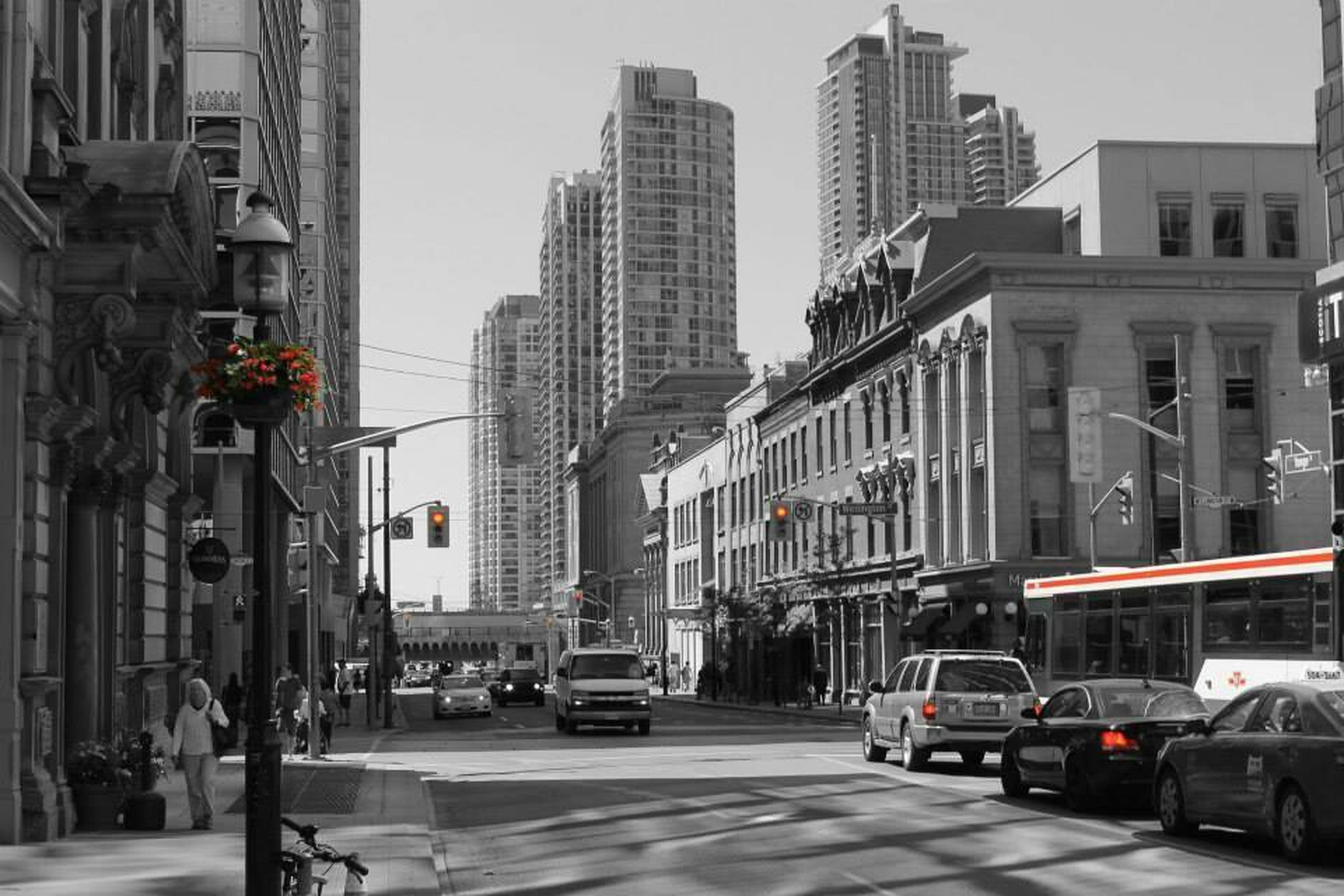 building exterior, car, architecture, transportation, land vehicle, built structure, street, city, mode of transport, road, city life, city street, traffic, incidental people, building, on the move, road marking, vehicle, the way forward, day