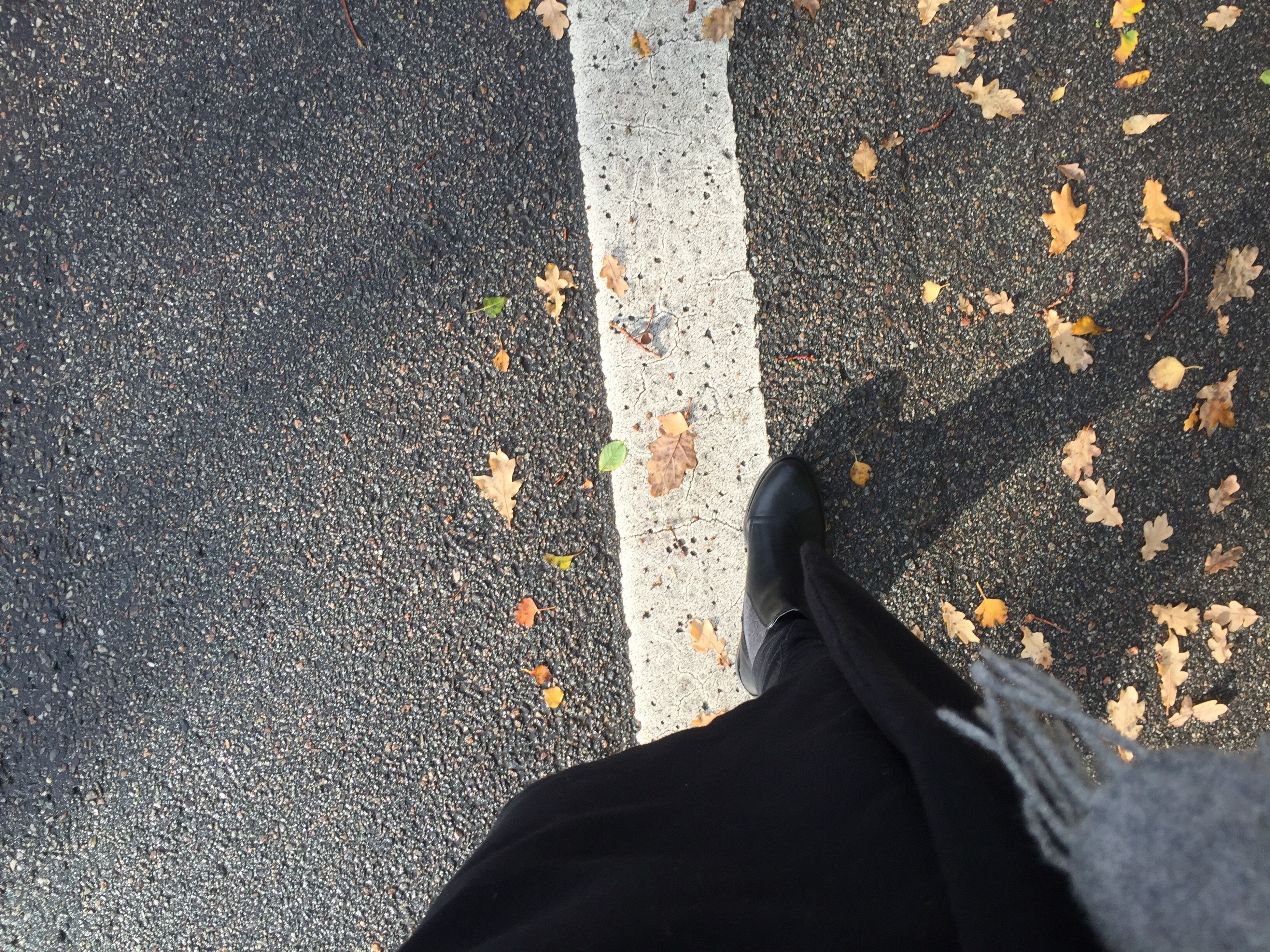 transportation, road marking, road, asphalt, low section, street, person, standing, personal perspective, day, limb, line