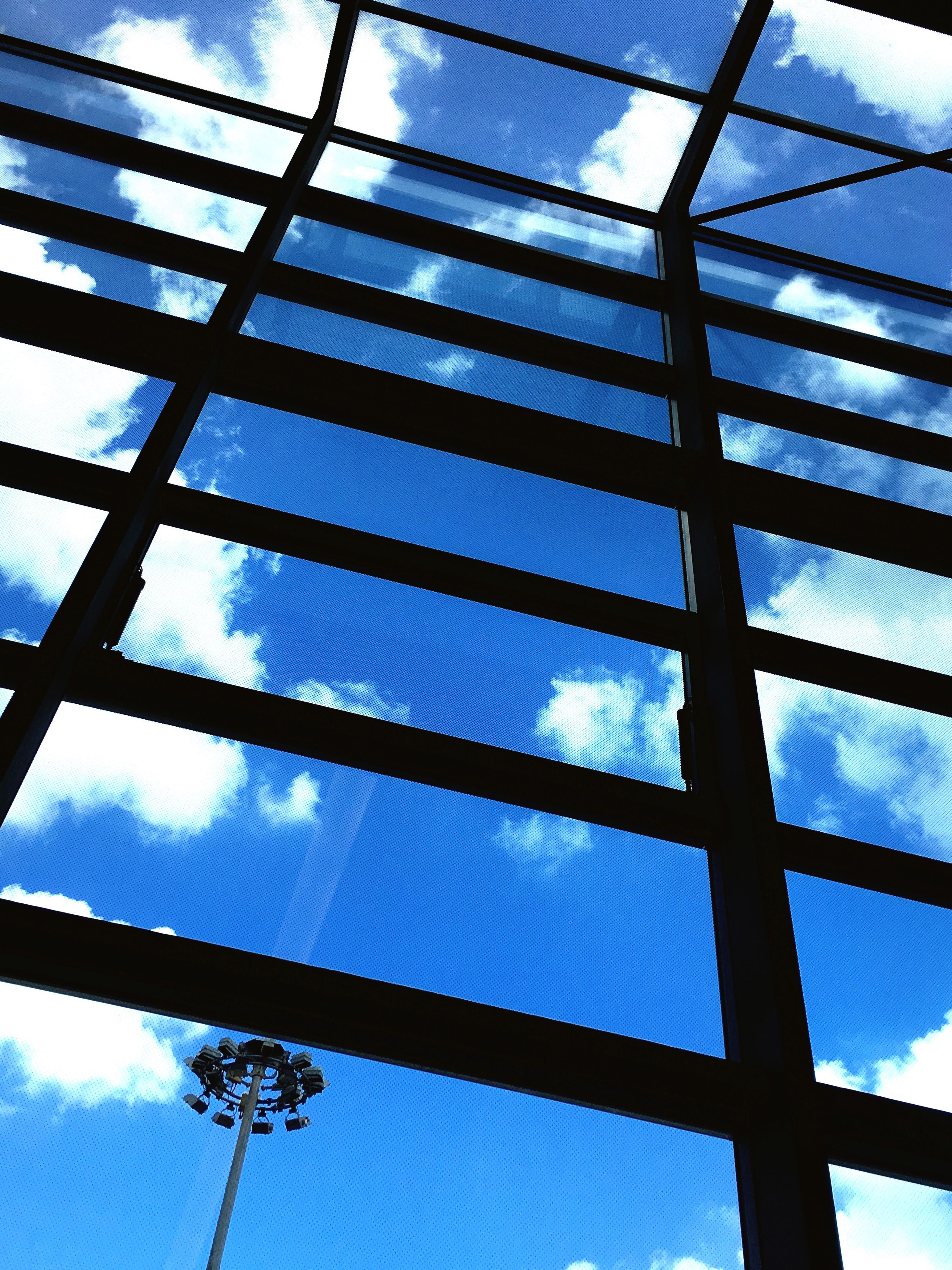 low angle view, full frame, backgrounds, blue, sky, cloud, day, office building, outdoors, repetition, modern, iron - metal, tall - high, power line, cloud - sky