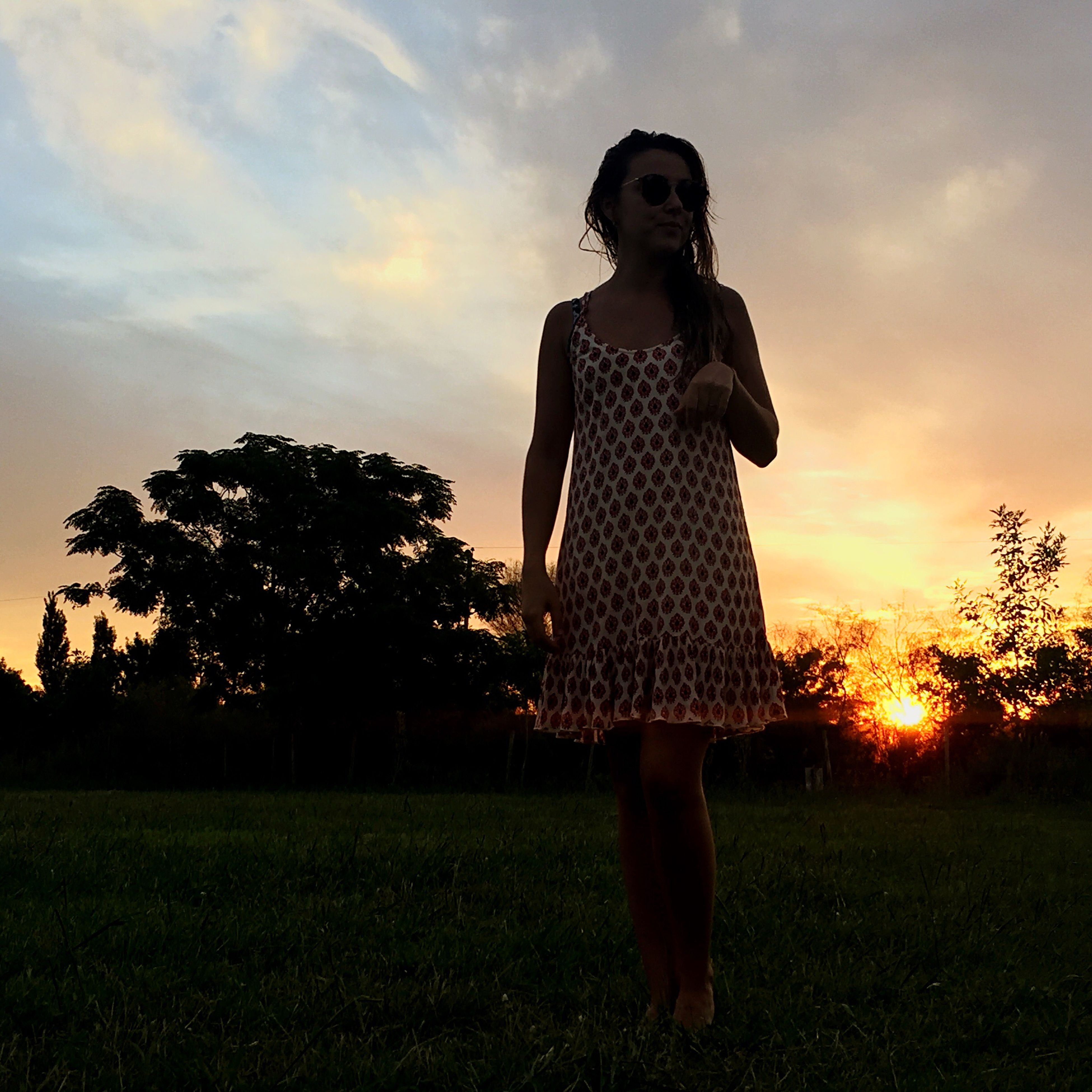 sunset, beauty, sky, fashion, grass, one person, young adult, outdoors, one young woman only, field, people, one woman only, tree, adult, adults only, beauty in nature, nature, day