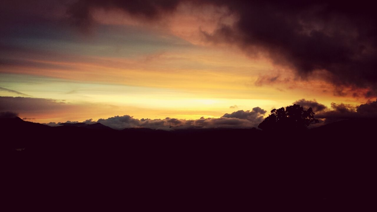 sunset, beauty in nature, scenics, nature, silhouette, tranquil scene, tranquility, sky, majestic, cloud - sky, dramatic sky, idyllic, no people, landscape, mountain, outdoors, tree, day