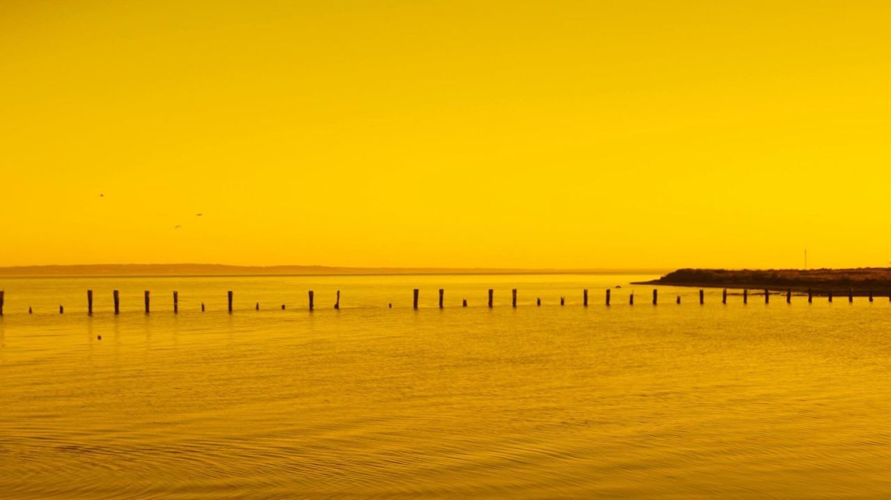 Sunset Werribee South Beach Water Scenics Tranquil Scene Tranquility Sea Sunset Yellow Wooden Post Calm Beauty In Nature Idyllic Clear Sky Waterfront Non-urban Scene Majestic Nature Ocean Sky Seascape Remote