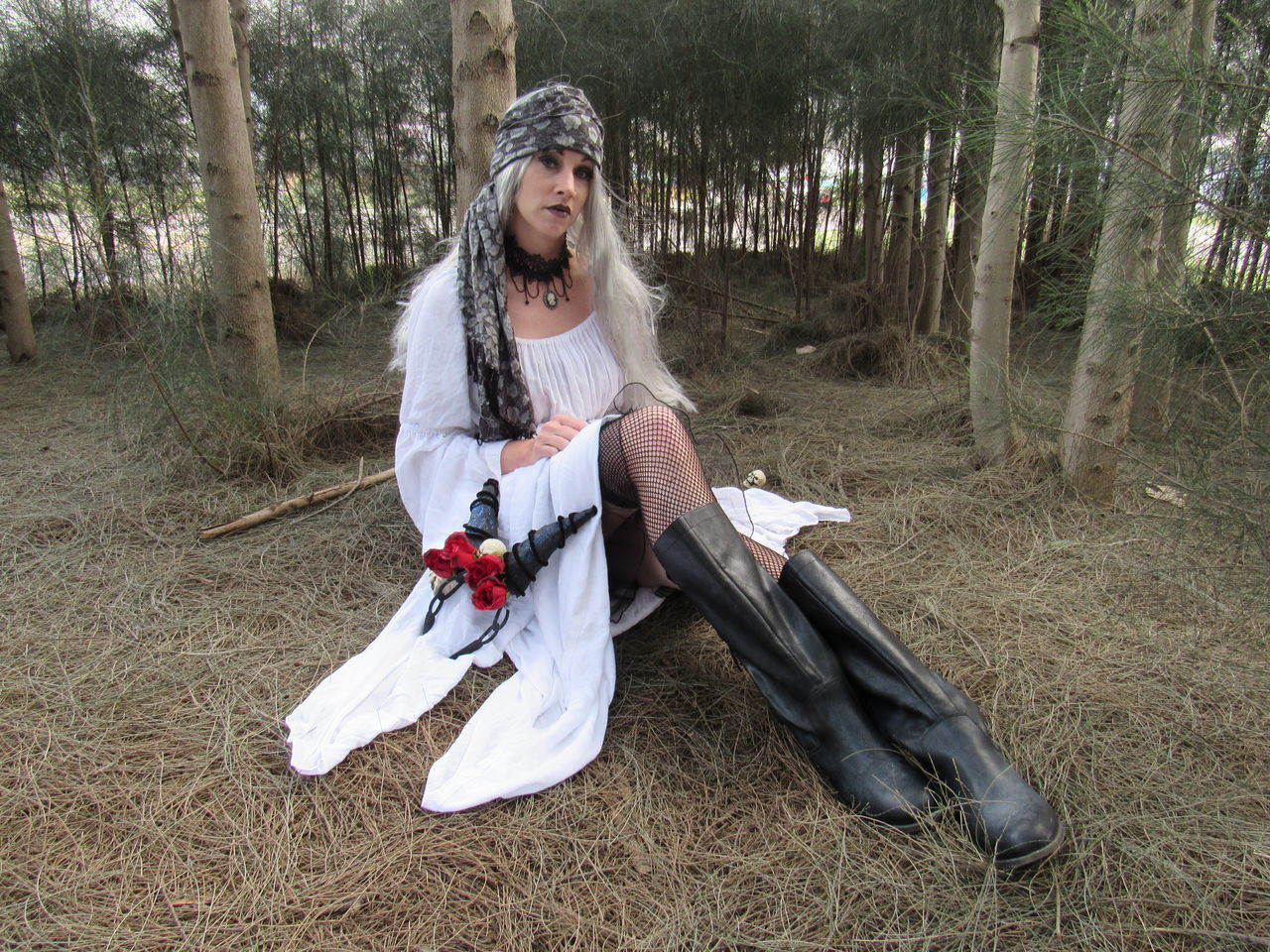 Deep in the Forrest Beauty In Nature Being Alone Female Model Forrest Photography Leather Photo Shoot Posing For The Camera Scarf Season Setting On Ground White Clothing Premium Collection