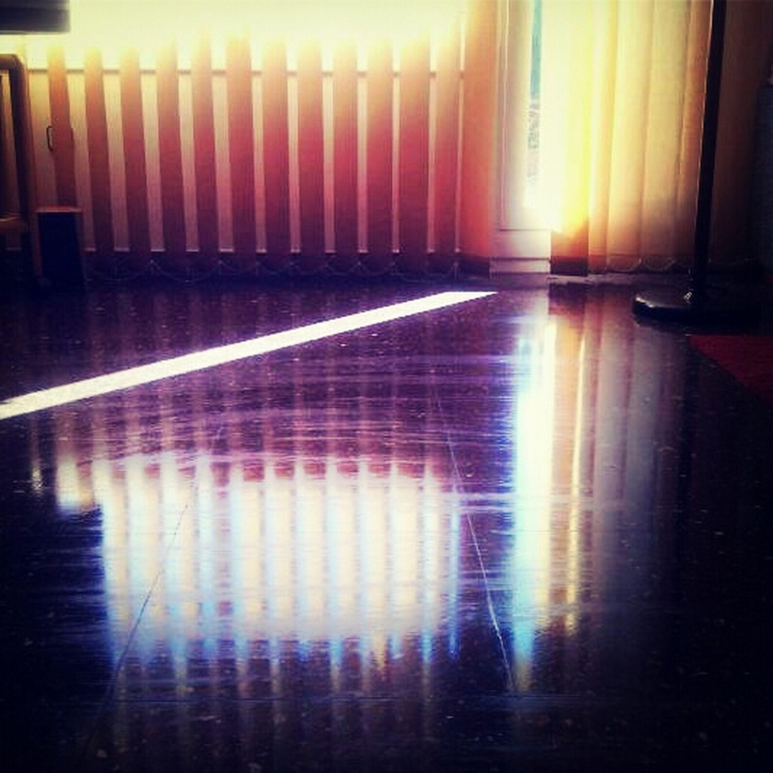 indoors, reflection, illuminated, sunlight, flooring, lens flare, built structure, sun, sunset, empty, sunbeam, light - natural phenomenon, shadow, architecture, no people, window, orange color, lighting equipment, glowing, silhouette