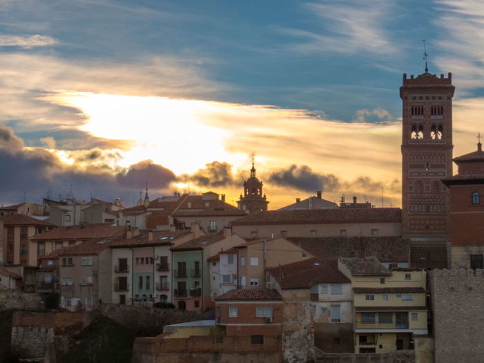Sun coming like a flame out of a medieval tower Architecture Building Exterior Built Structure City Cityscape Cloud - Sky Day Mudéjar Style No People Outdoors Residential Building Sky Tourism Travel Destinations The Street Photographer - 2017 EyeEm Awards Paint The Town Yellow