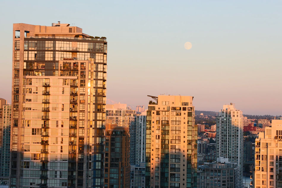 Architecture City Cityscape Day Moon Moon At Day No People Outdoors Sky Skyscraper Sunset Urban Skyline