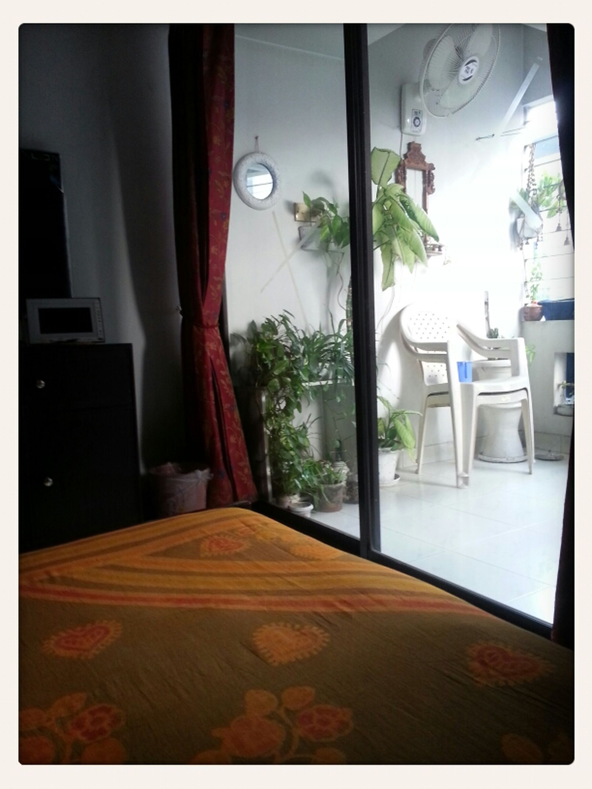 indoors, transfer print, auto post production filter, table, home interior, absence, chair, window, empty, flooring, tiled floor, no people, restaurant, sunlight, glass - material, potted plant, house, illuminated, lighting equipment, transparent