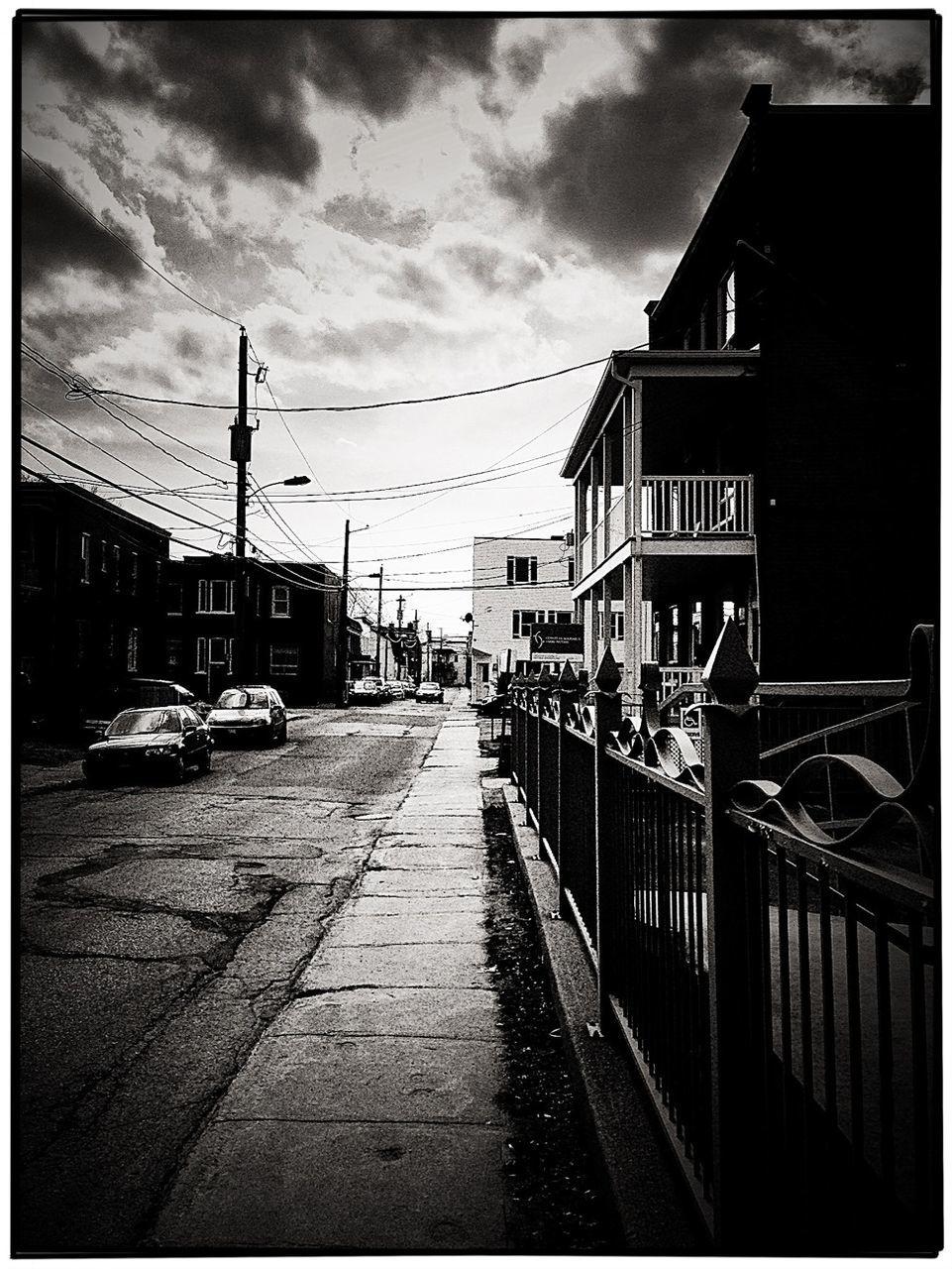 Sidewalk By Houses Against Sky