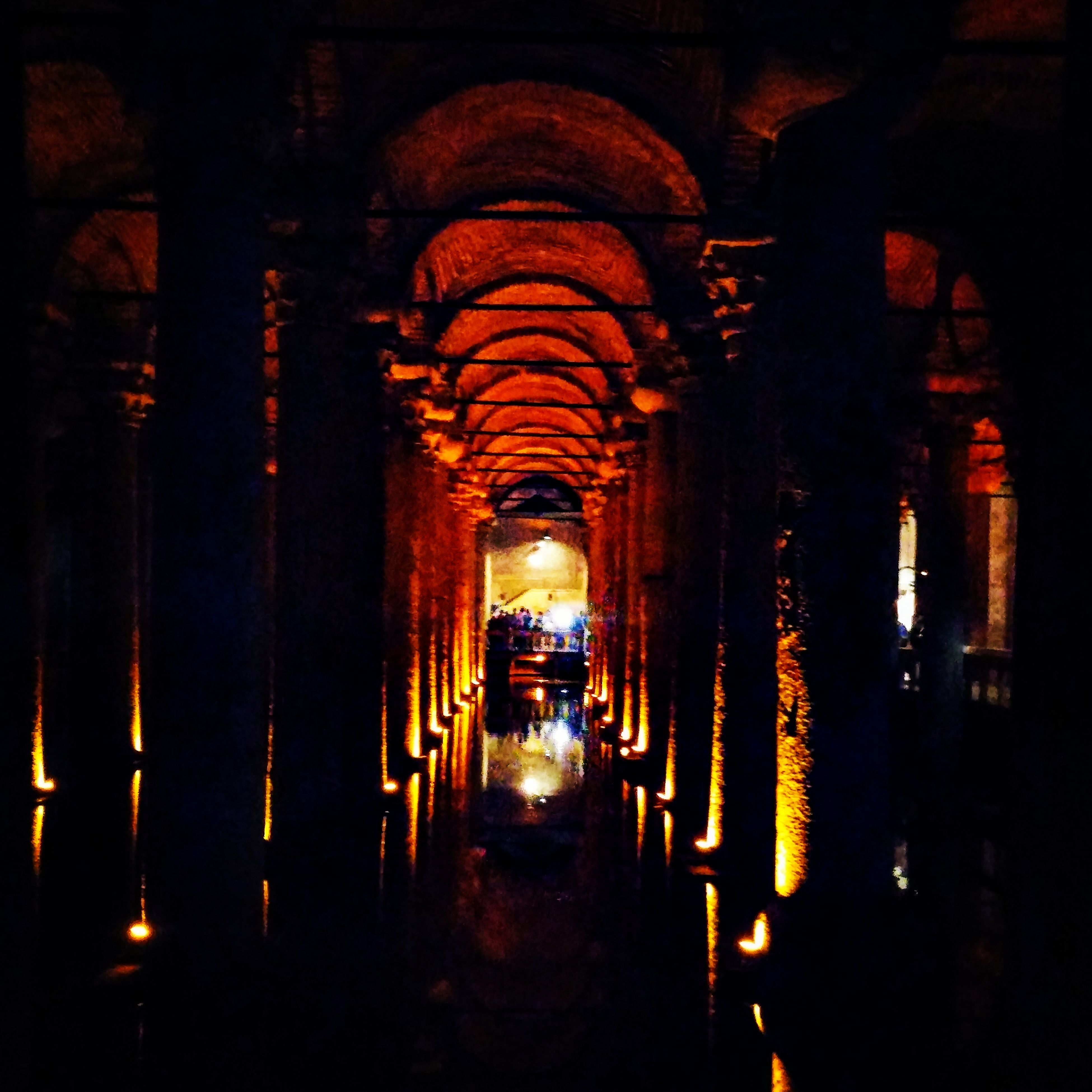 place of worship, religion, arch, spirituality, indoors, illuminated, architecture, church, built structure, architectural column, in a row, temple - building, history, dark, lighting equipment, night, old, famous place