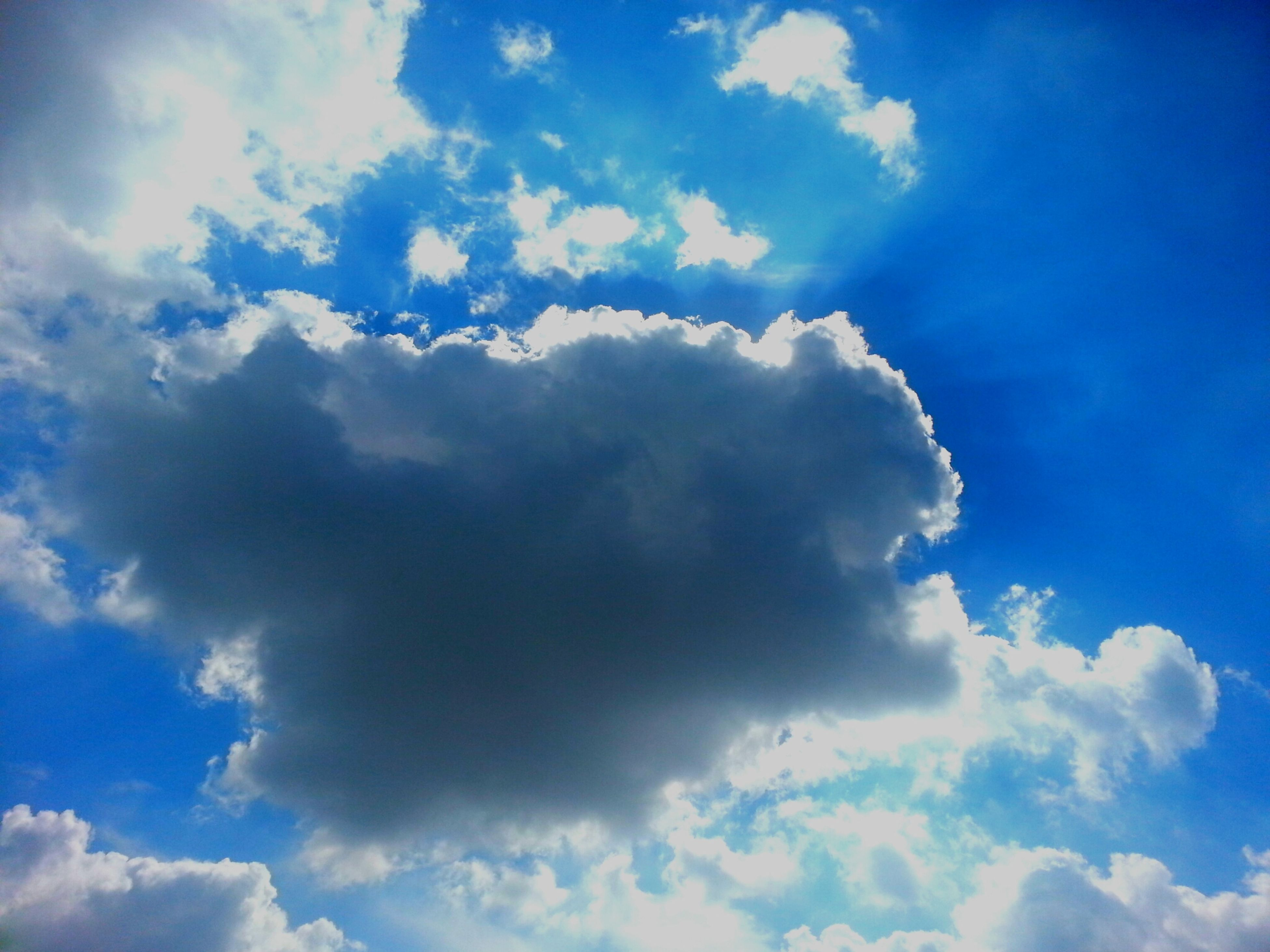 sky, blue, low angle view, cloud - sky, beauty in nature, sky only, tranquility, scenics, nature, cloudy, cloudscape, cloud, tranquil scene, backgrounds, idyllic, white color, outdoors, day, fluffy, no people