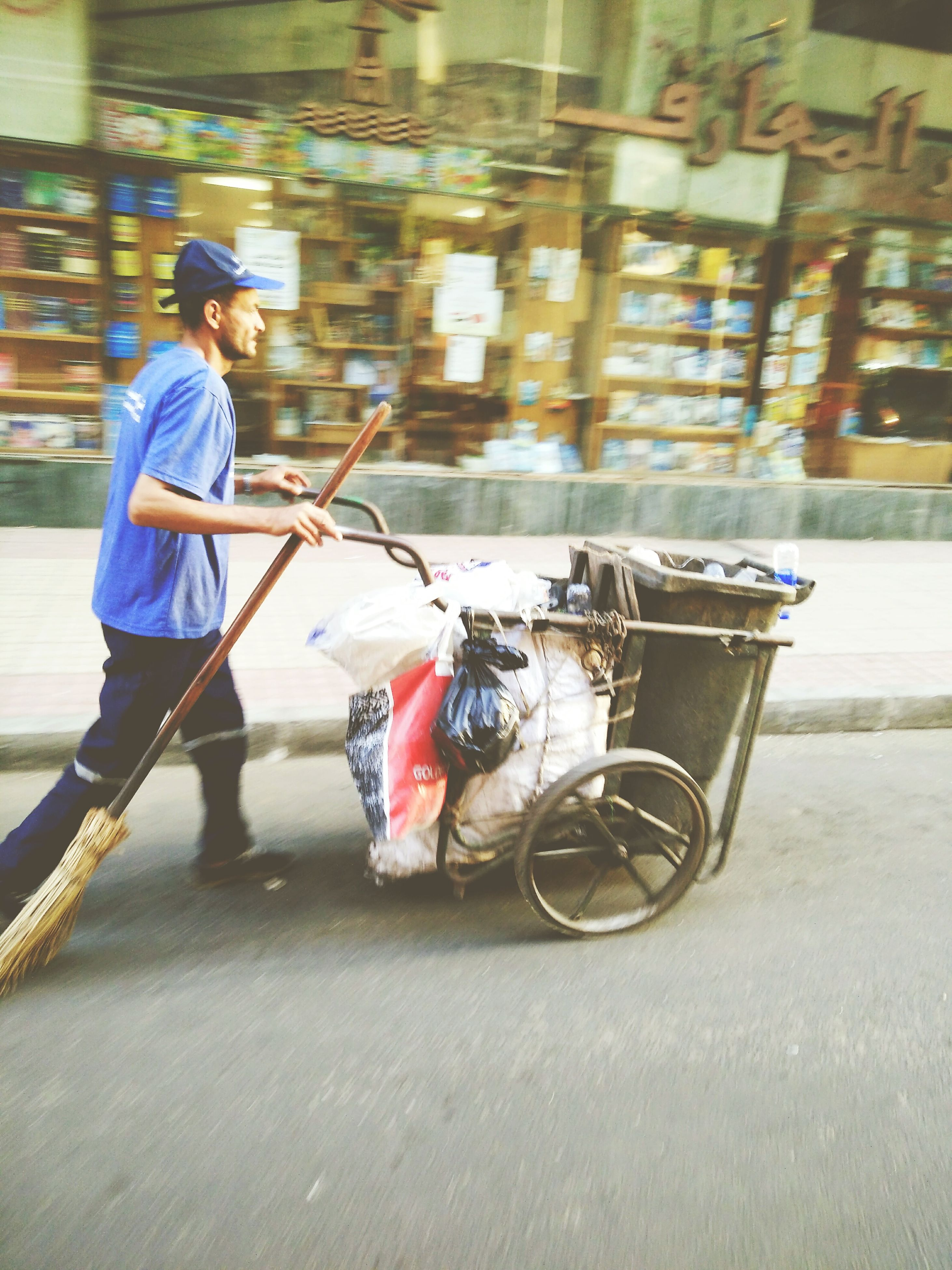 mode of transport, transportation, bicycle, land vehicle, casual clothing, full length, travel, city, road, lifestyles, street, city life, holding, person, young adult, outdoors, day