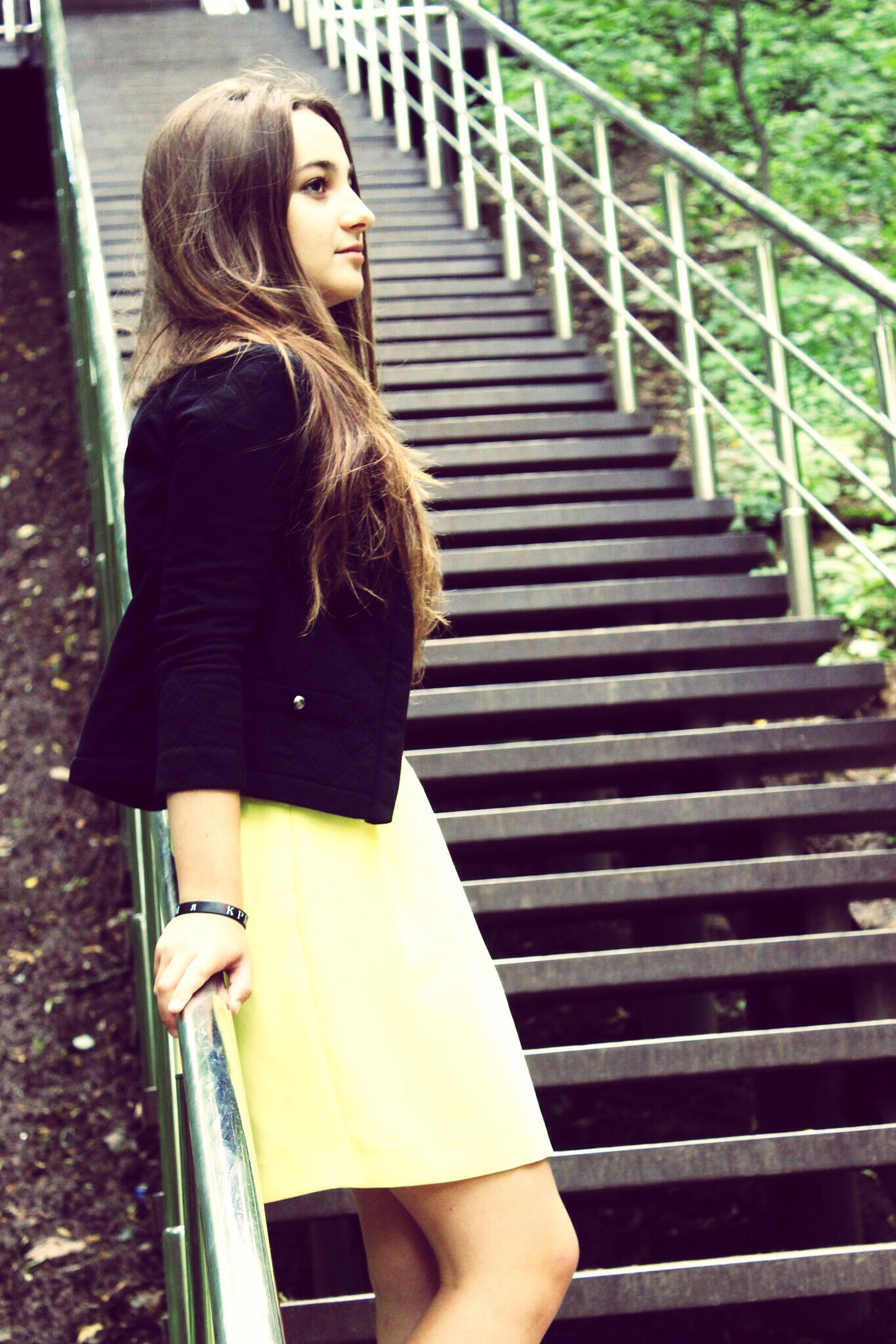 lifestyles, leisure activity, young adult, casual clothing, standing, young women, three quarter length, steps, person, long hair, railing, sitting, blond hair, day, outdoors, full length