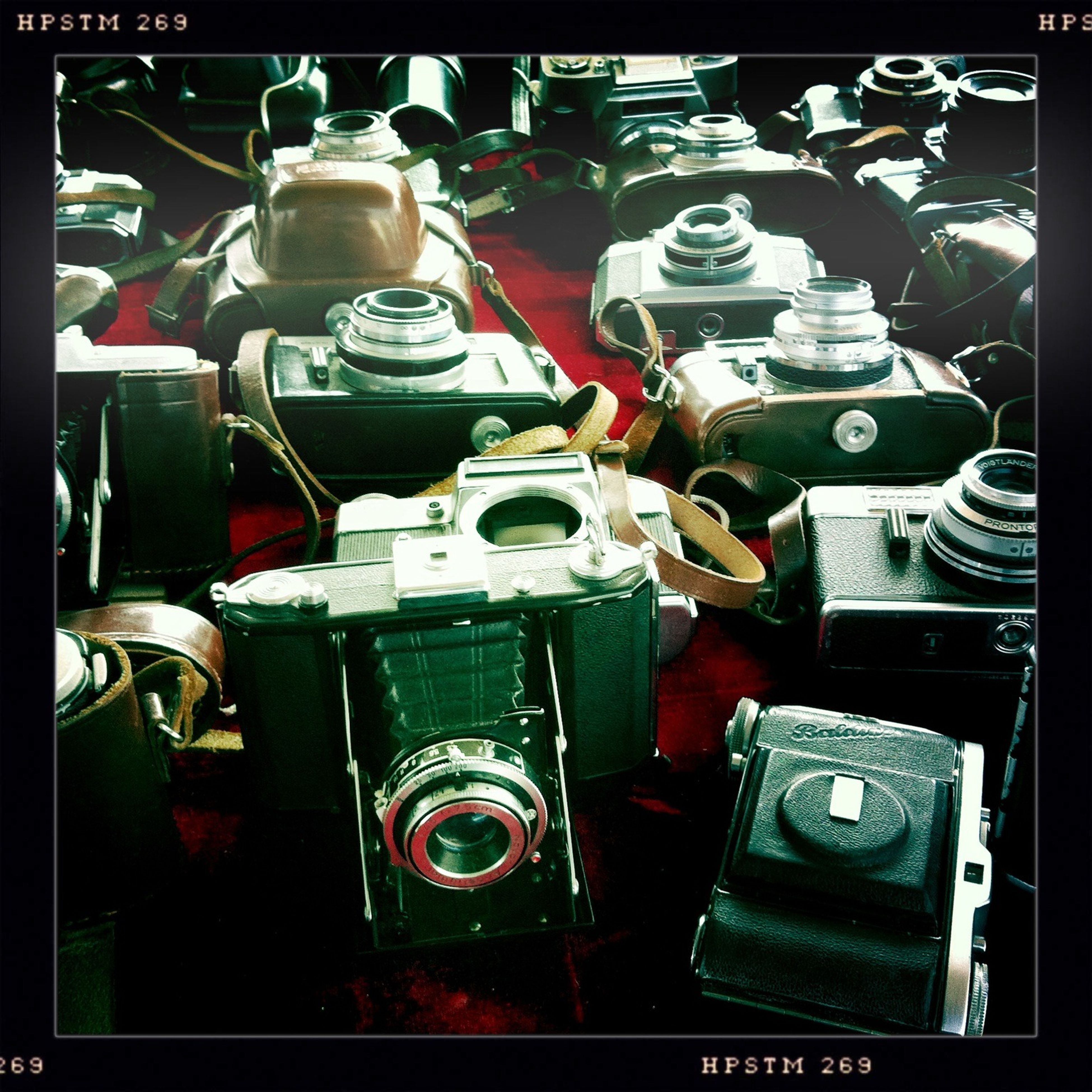 transfer print, indoors, auto post production filter, large group of objects, technology, still life, close-up, variation, abundance, equipment, retro styled, choice, table, metal, high angle view, old-fashioned, arrangement, stack, no people, antique