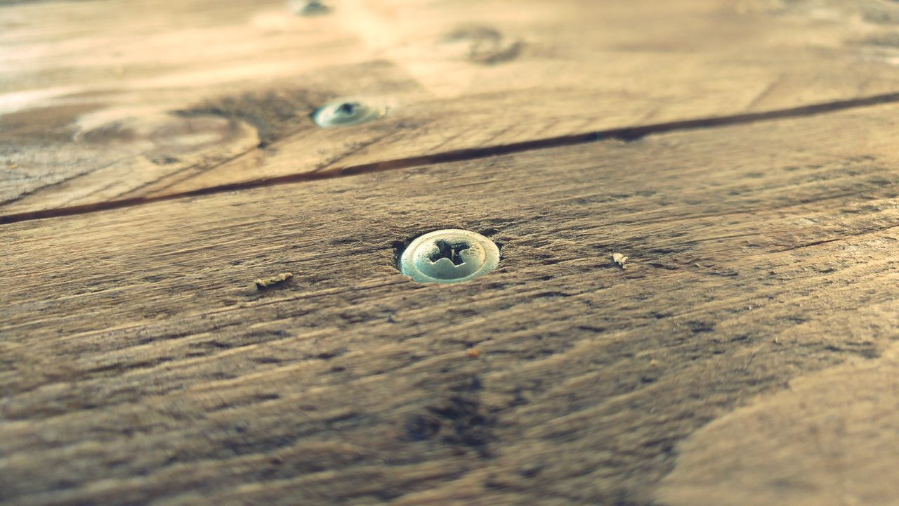 selective focus, wood - material, table, no people, close-up, textured, full frame, button, day, outdoors