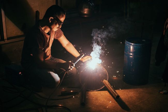 A Welder Making A Seat The Street Photographer - 2016 EyeEm Awards Human Meets Technology Electro Working Welding EyeEm Best Shots Fire Handmade Eye4photography  Hardwork Fujifilm EyeEm Gallery Showcase April Working Hard