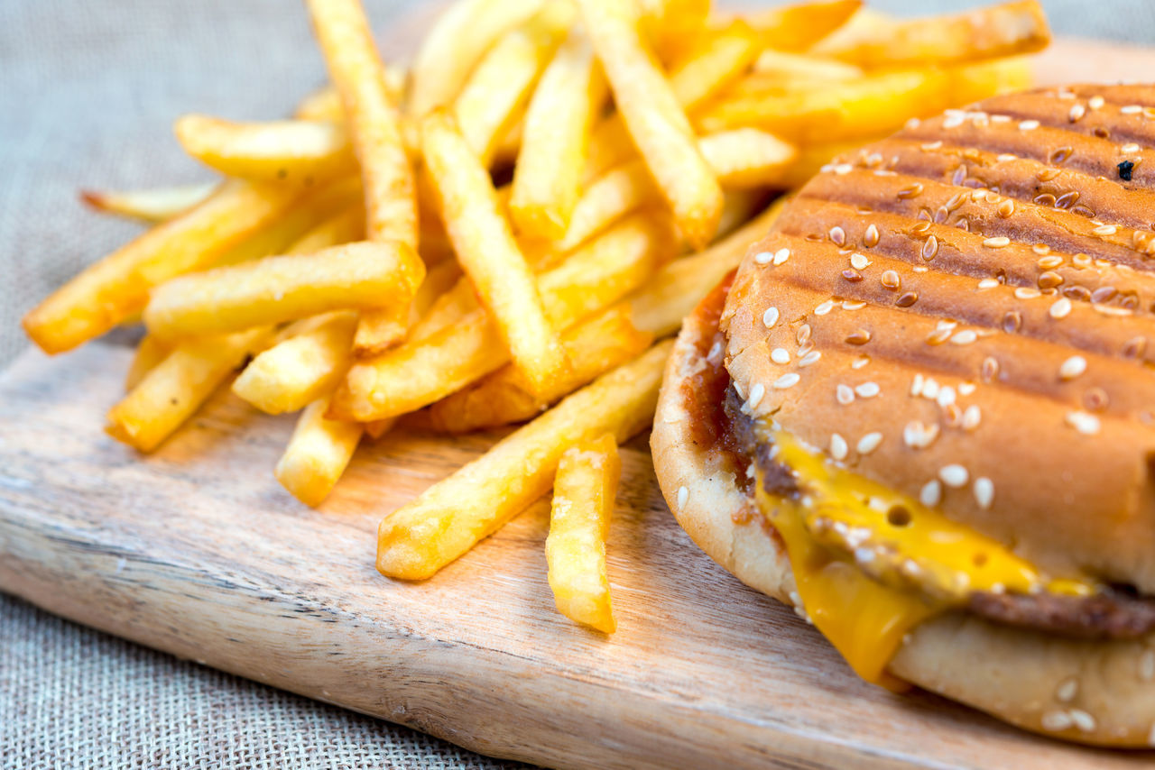 Burger Close-up Convenience Food Day Deep Fried  Fast Food Food Food And Drink French Fries Freshness Fried Hamburger Indoors  No People Potato Chip Prepared Potato Ready-to-eat SLICE Snack Take Out Food Unhealthy Eating