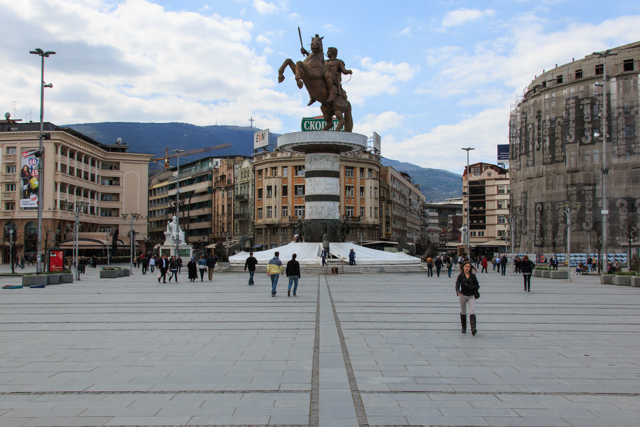 Square Makedonia, the capital's main square, with people passing by and Alexander the Great statue on background. Architecture Art Art And Craft Balkans Building Exterior Built Structure City City Life Creativity Culture East Europe Horse Human Representation In Front Of Macedonia Memories Monument Pedestal Person Sculpture Skopje Sky Statue Town Square Travel Destinations