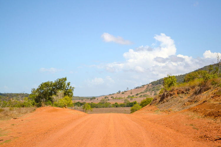 Just drive Australia Clear Sky Clouds Day Dirt Road Landscape Nature No People Outback Outdoors Remote Location Road Road To Nowhere Road Trip Sky Travel Tree Finding New Frontiers