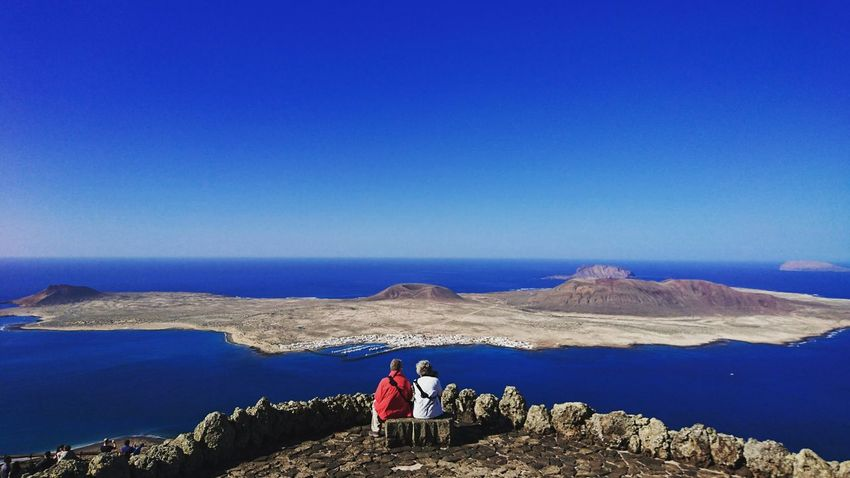Travelling. Together. Two People Beauty In Nature Mountain Scenics People Couple Together Couples Shoot Togetherness Lanzarote-Canarias Lanzarote Landscape Beauty In Nature Coastline Island In The Sun Nature Landscapes Amazing View Colors Of Nature Let's Go. Together.