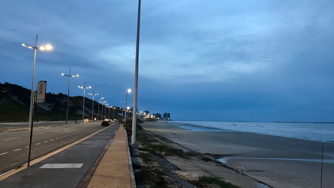 sea, sky, transportation, cloud - sky, nature, street light, outdoors, water, horizon over water, beauty in nature, road, beach, scenics, no people, blue, day