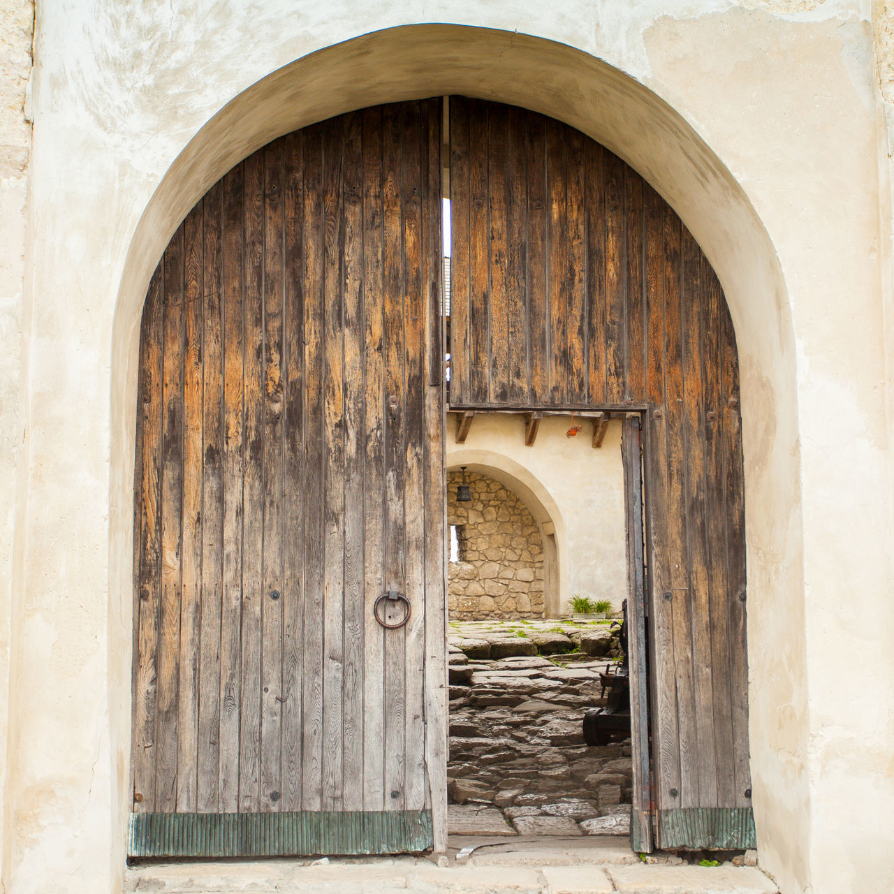 An old opened wooden door with hinge and rough texture Ancient Antique Arch Architecture Brown Building Exterior Built Structure Day Door Entrance Entrance Facade Building Gates House No People Outdoors Retro Ruin Rustic Vintage Wood - Material