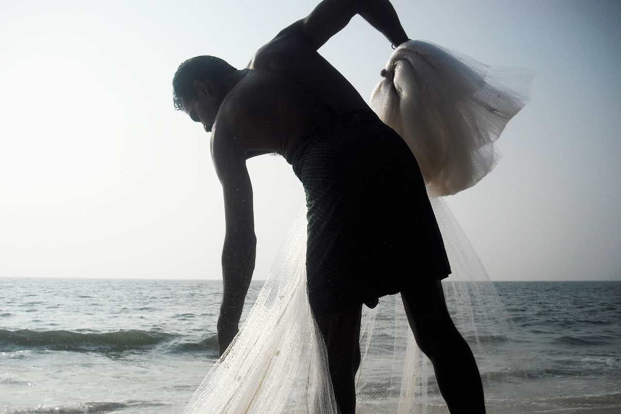 Beautiful stock photos of man, 50-54 Years, Beach, Cochin, Day