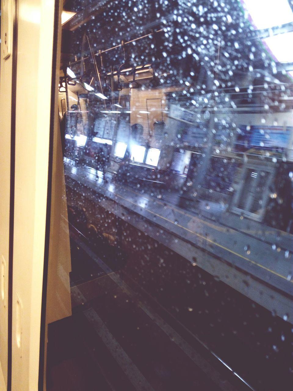 transportation, rail transportation, public transportation, railroad station, railroad track, railroad station platform, window, architecture, train - vehicle, indoors, built structure, illuminated, building exterior, night, no people, city
