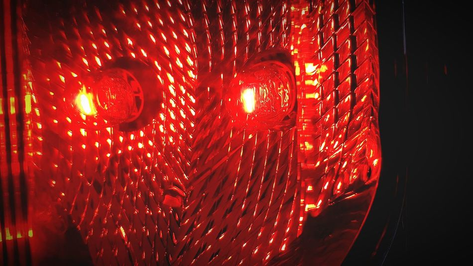 Red Illuminated No People Indoors  Close-up Backgrounds Night Red Light Brake Lights