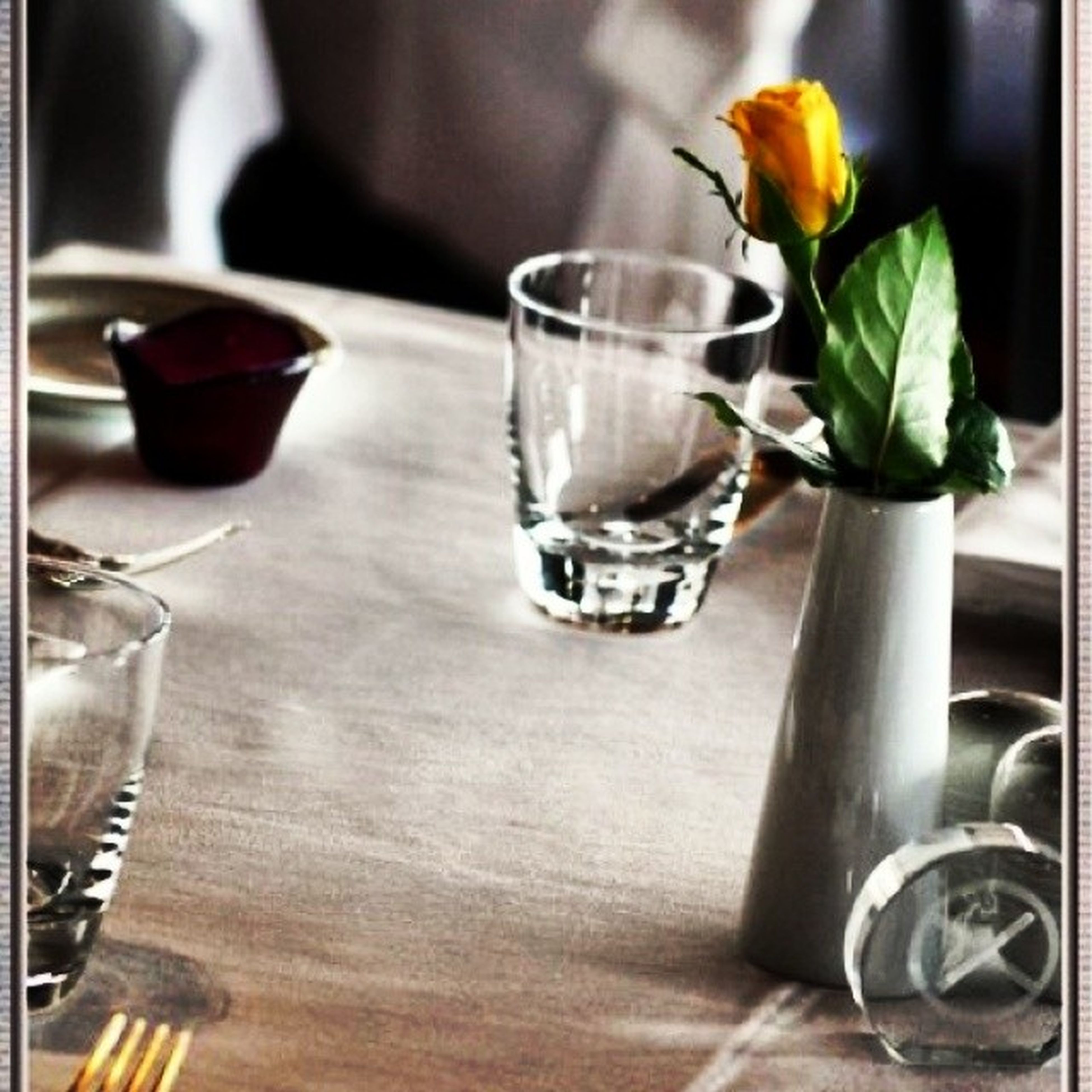 indoors, table, still life, freshness, vase, flower, food and drink, glass - material, close-up, drinking glass, home interior, drink, focus on foreground, bottle, restaurant, selective focus, no people, glass, potted plant, wood - material