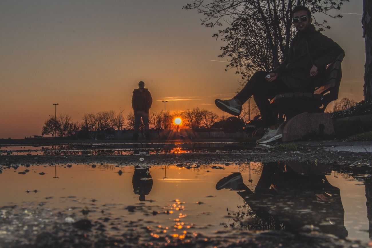 The City Light Reflection Water Sunset Tree Real People Sky Men Outdoors Leisure Activity Nature Silhouette Scenics One Person Beauty In Nature Day First Eyeem Photo The City Light