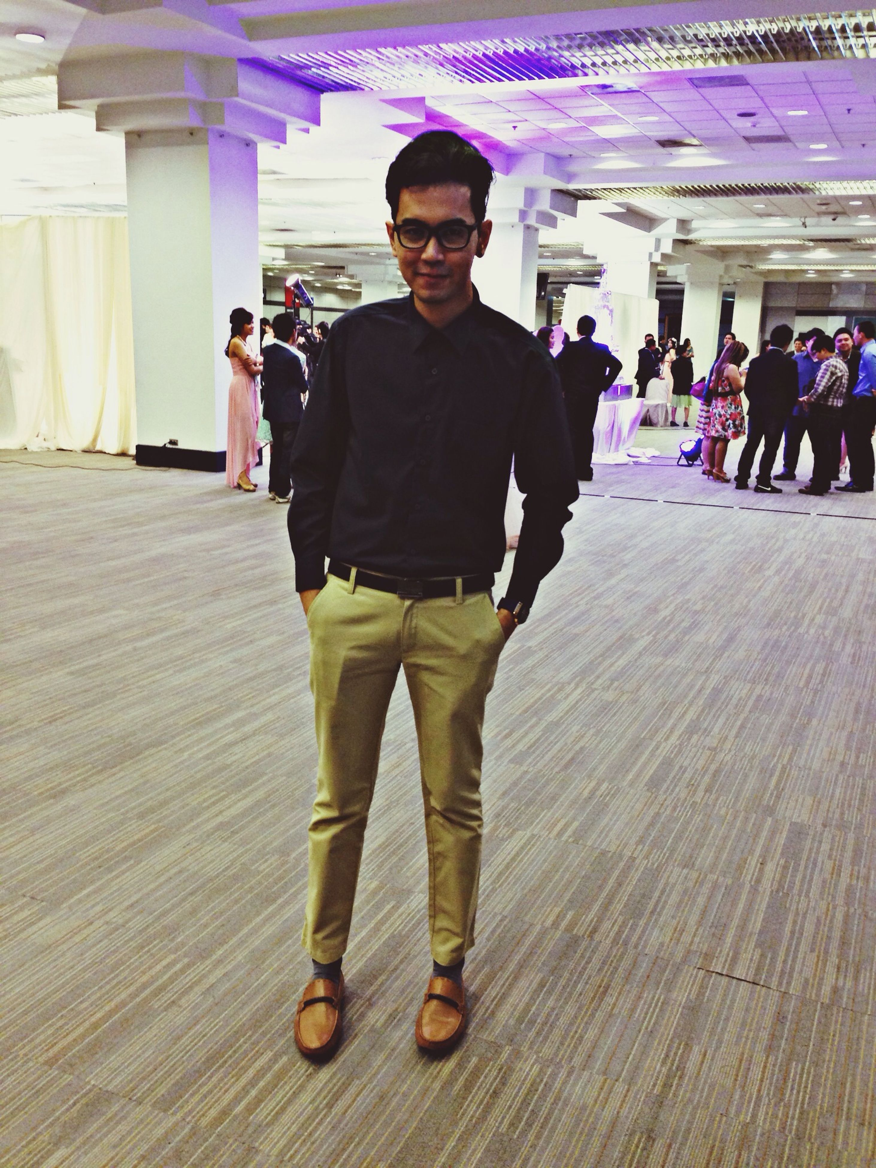 lifestyles, casual clothing, young adult, indoors, leisure activity, standing, front view, looking at camera, portrait, person, built structure, architecture, full length, young men, sunglasses, incidental people