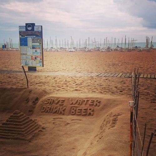 Save Water Drink Beer Albufeira Portugal Sand Beach Sea Outdoors Text Water Nature Travel Destinations Travel