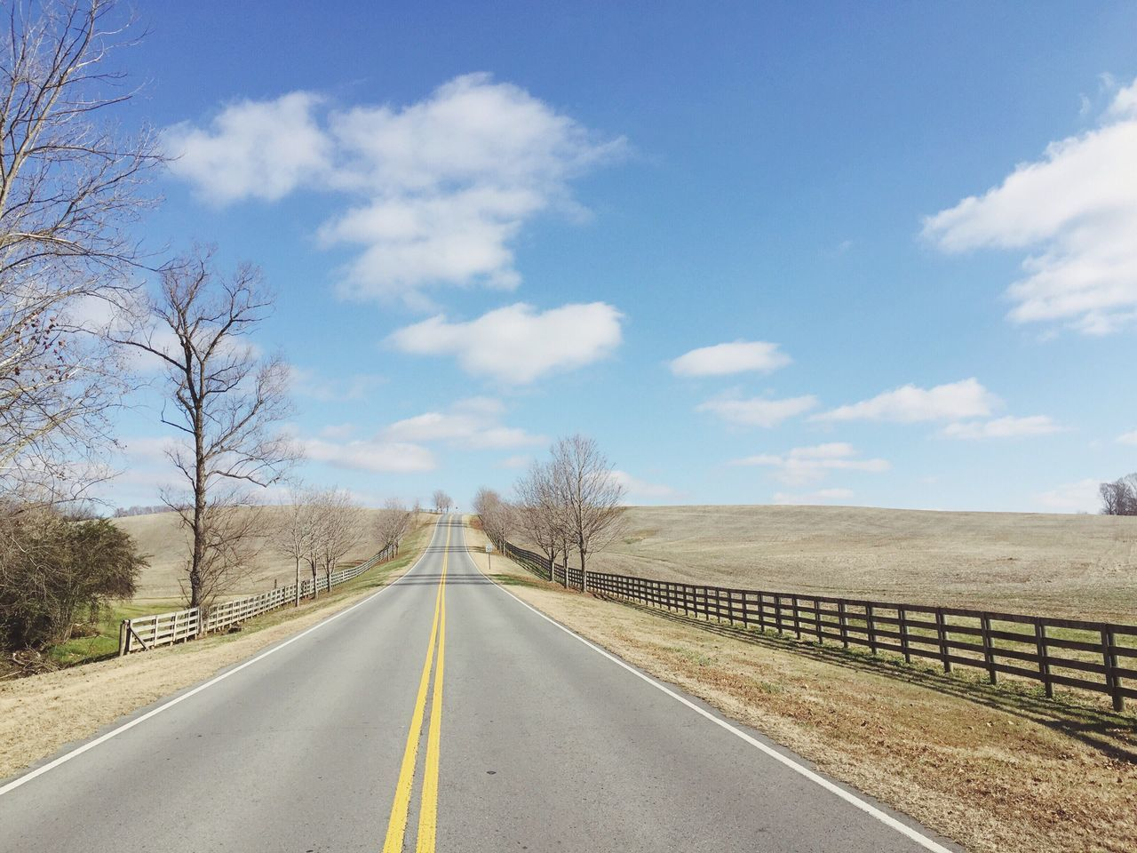 Road The Way Forward Sky Day Transportation Outdoors No People Landscape Cloud - Sky Scenics Nature Beauty In Nature Tranquility Winter Rural America Rural Scene Bare Tree Farmland Fence Tranquil Scene EyeEm Best Shots Country Road