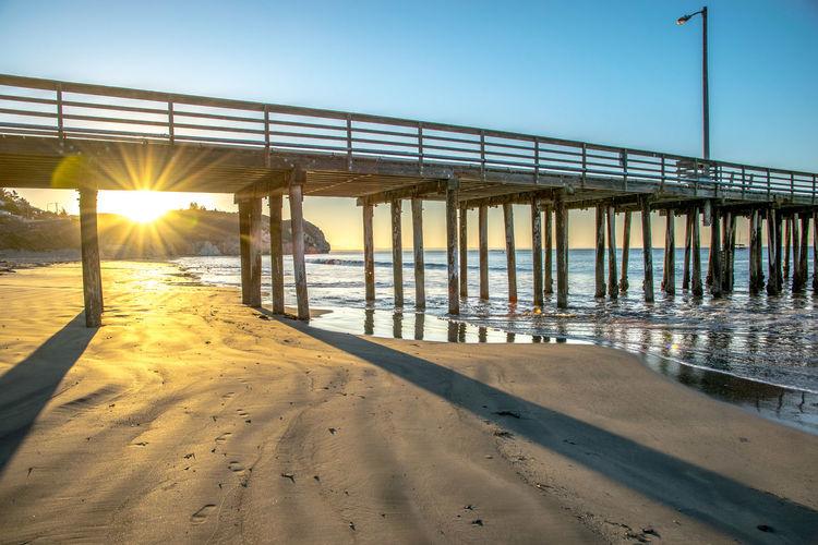 Avila Beach CA Pier Beach Beauty In Nature Clear Sky Horizon Over Water Nature Outdoors Sand Sea Sunlight Sunrise Sunset Water