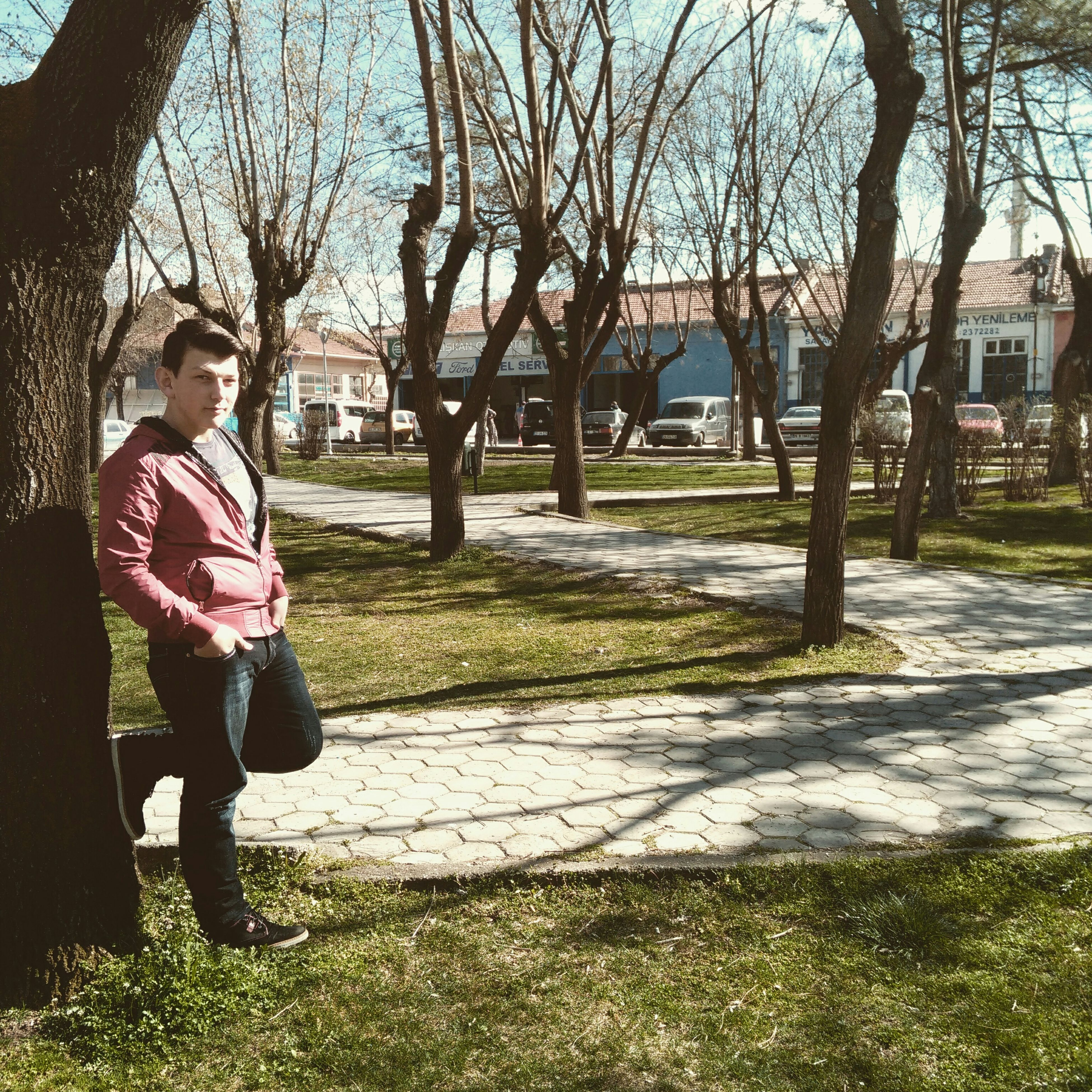 tree, lifestyles, full length, casual clothing, leisure activity, person, building exterior, built structure, standing, childhood, architecture, grass, elementary age, girls, park - man made space, young adult, boys, sunlight