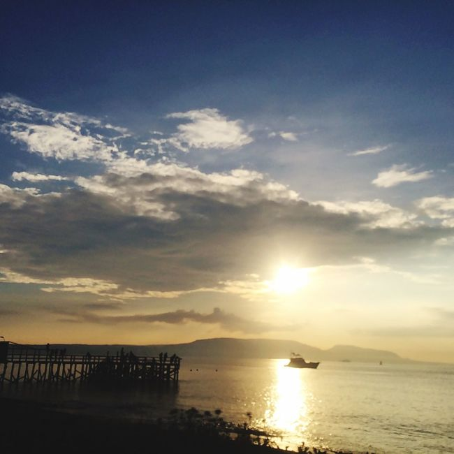 Water Tranquil Scene Scenics Tranquility Sunset Beauty In Nature Sea Reflection Sky Sun Calm Cloud Nature Idyllic Mountain Ocean Majestic Cloud - Sky Sunbeam Outdoors