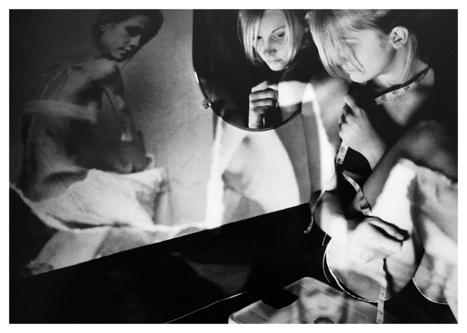 """Obsessions 4. From my series of 12 photos, entitled """"Addictions, Obsessions, Compulsions"""". Shot on Kodak TMax 100 film with my Canon EOS Rebel K2. Conceptual Photography  Sandwiched Negatives Double Exposure Conceptual Image Obsessions Dying To Be Thin Anorexia Film Photography Conceptual Self Portrait Story Photography Contrast Blackandwhitephotography B&W_collection Cindy Sherman Inspired By Cindy Sherman Body Image"""