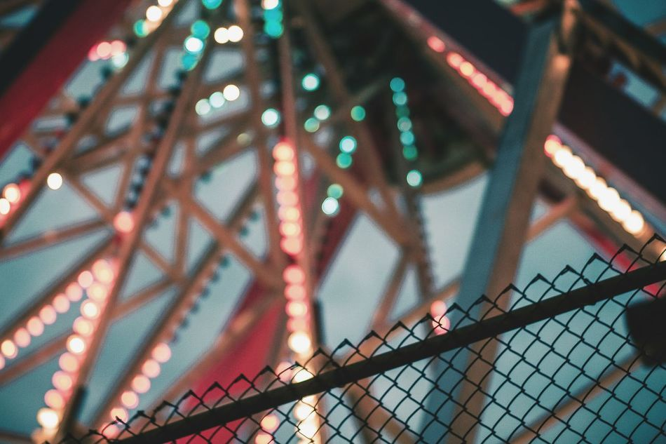 Low Angle View No People Pattern Close-up Multi Colored Illuminated Backgrounds Architecture Sky Dusk Carnival Carnival Rides Carnival Ride Fair Ferris Wheel Lights Fence Silhouette Heatercentral Moodygrams Visualarchitects Visualsgang Visualsoflife TheCreatorClass Liveauthentic