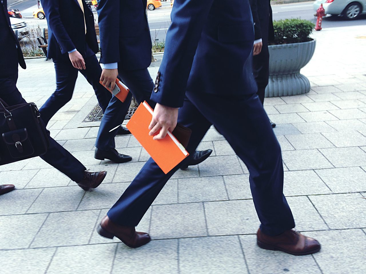 Low Section Of Businessmen Walking On Sidewalk