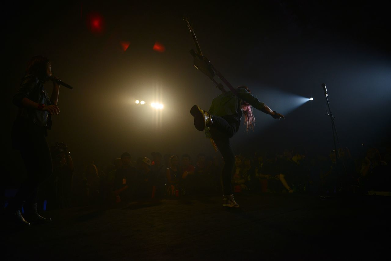 Arts Culture And Entertainment Concert Lighting Concert Photography Creative Light Long Hair Moshing Performance Performance Art Pop Punk Rock Music Stage - Performance Space Stage Jump Stage Lighting