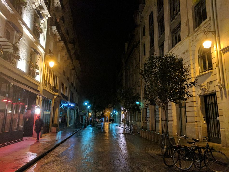 Paris By Night Week5 52WeekChallenge Illuminated Night City Street Street Light Architecture Road Outdoors One Man Only Nightphotography Streetphotography 52weeksplan 52frames 52 Weeks 52 Week Challenge Colors Street Colors Reflection Reflections In The Water Rain Rainy Day