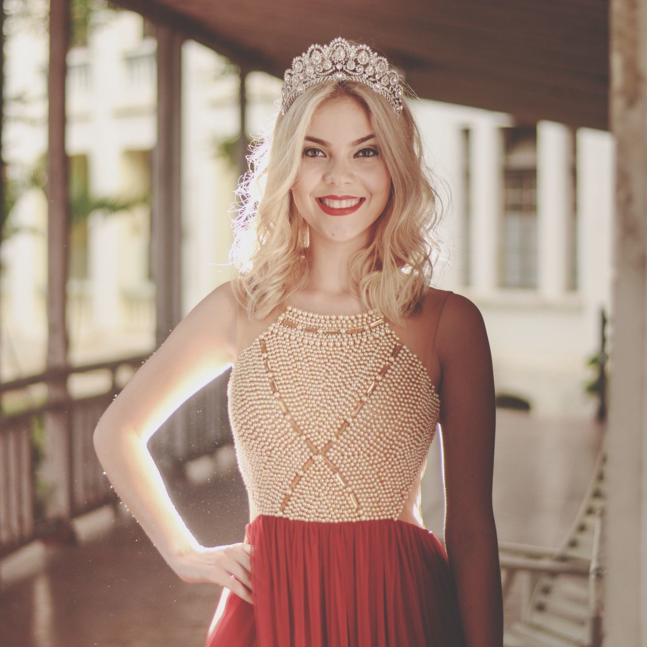 dress, young adult, beautiful woman, looking at camera, front view, portrait, one person, young women, real people, focus on foreground, smiling, happiness, fashion, blond hair, beauty, glamour, standing, beautiful people, fashion model, day, evening gown, outdoors, one young woman only, bride, people