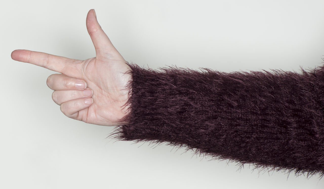 hand shows a gesture as a sign language Thumb Adult Adults Only Arm Body Part Concept Finger Fist Flawlessly Forefinger Gesture Gestures Human Body Part Human Hand People Sensually Strong Sign Language Snugly Stretching Symbol Women Hand Wool