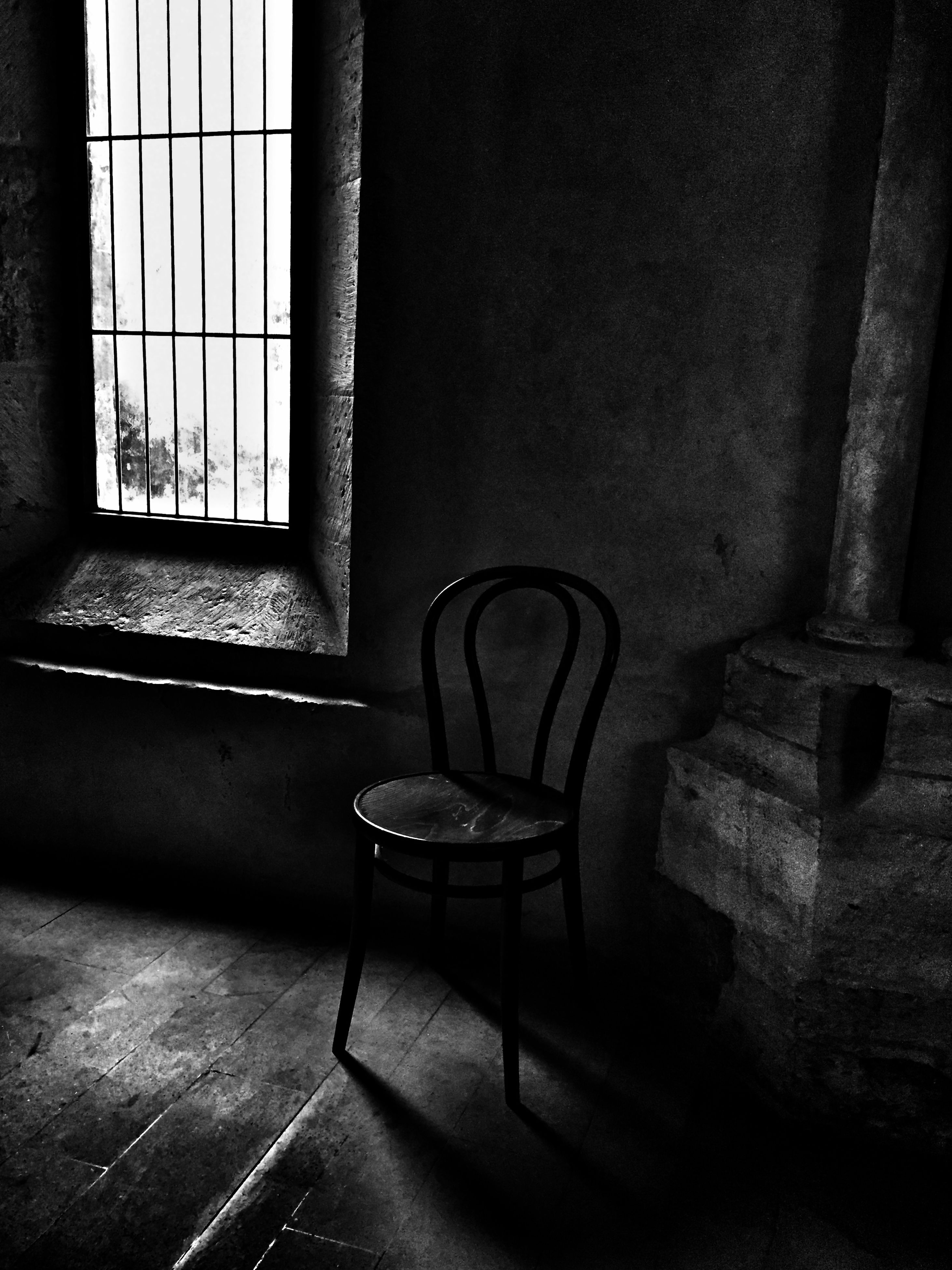 indoors, architecture, chair, built structure, empty, absence, window, flooring, sunlight, shadow, tiled floor, wall - building feature, home interior, interior, furniture, corridor, wall, seat, day, old