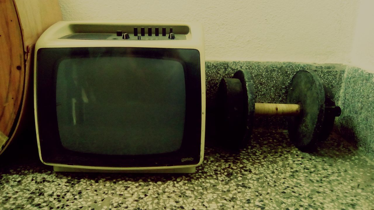 television set, communication, indoors, no people, close-up, day