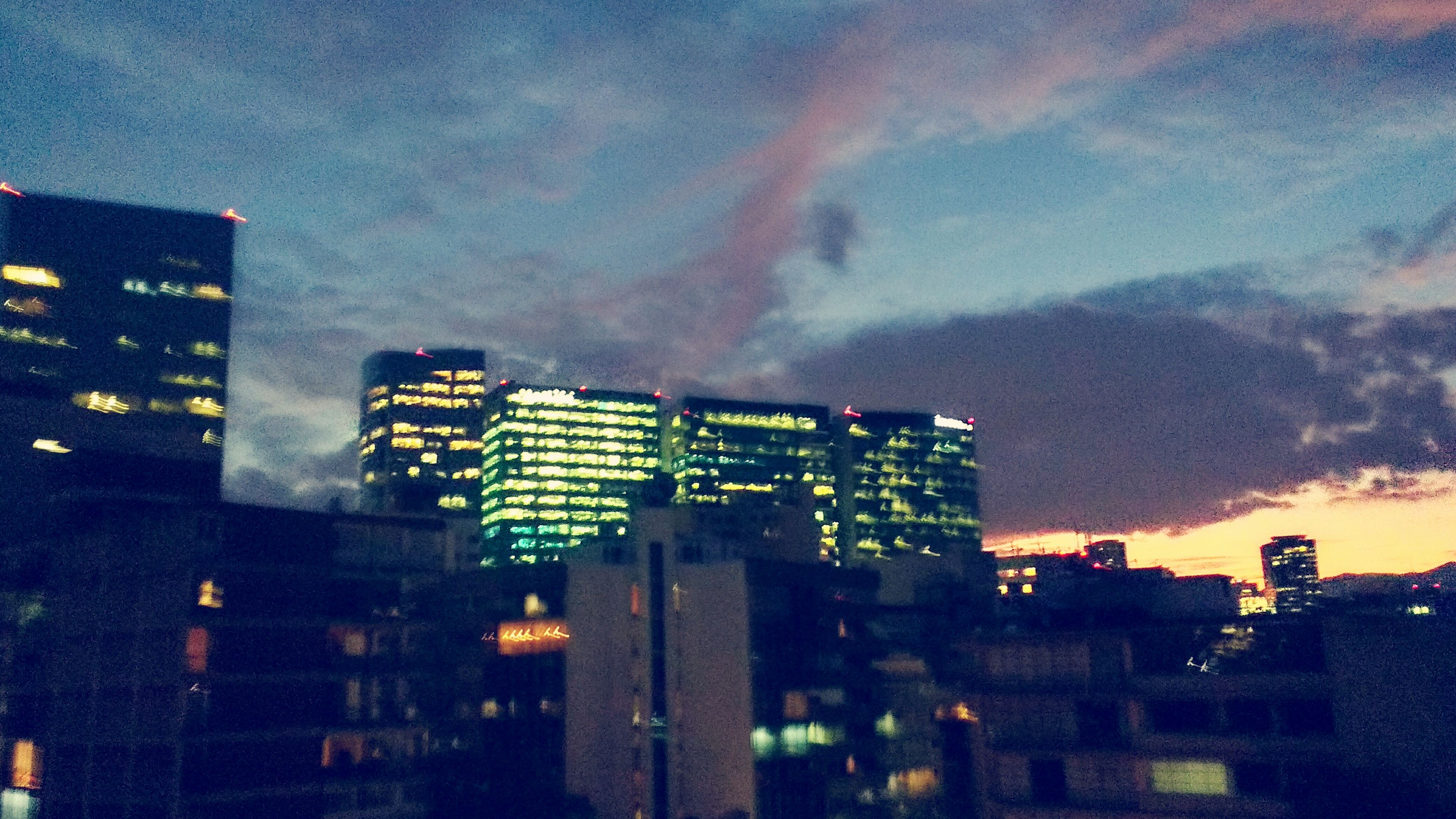 sky, building exterior, built structure, architecture, cloud - sky, text, illuminated, communication, city, low angle view, outdoors, cloudy, dusk, no people, western script, cloud, night, street light, lighting equipment, building