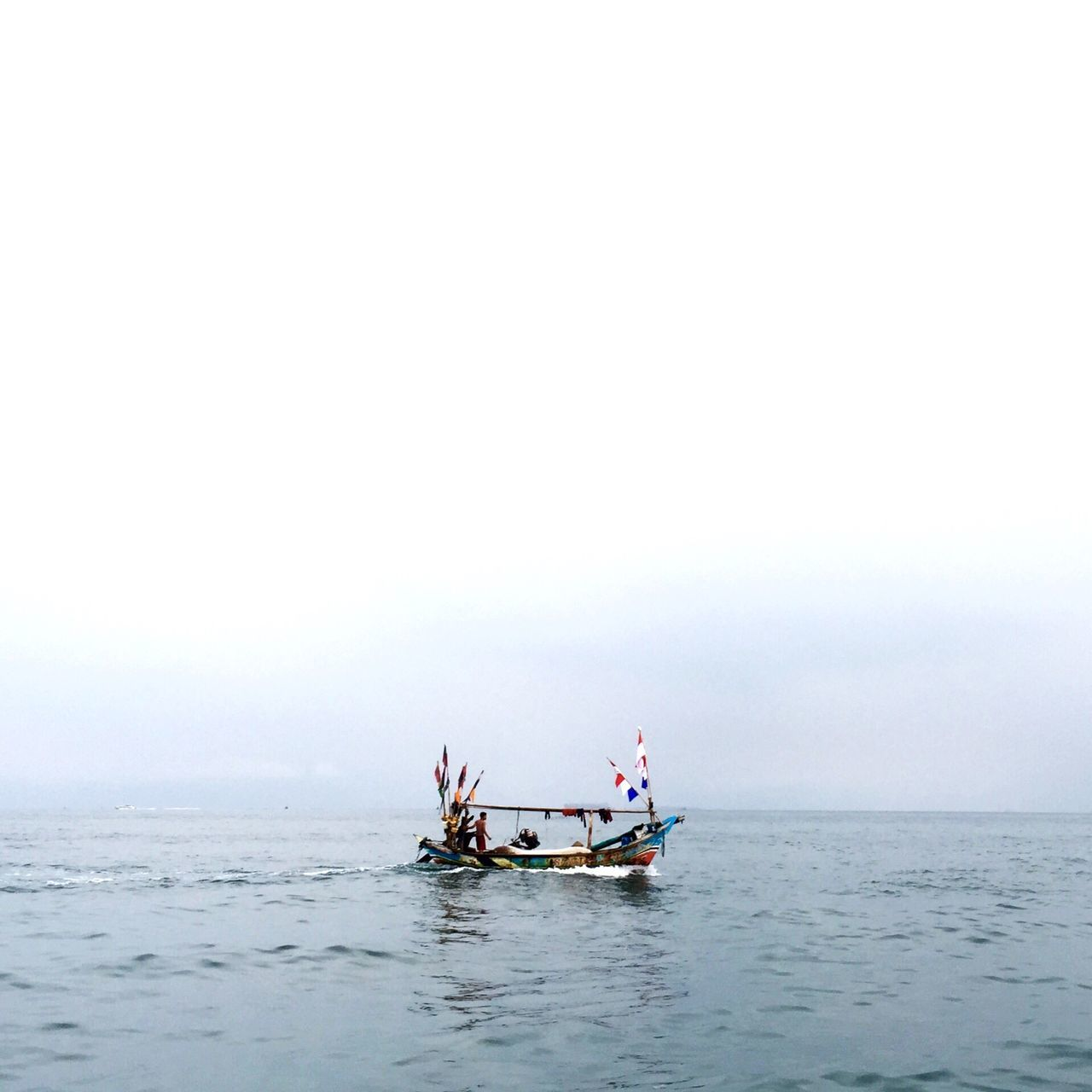 sea, horizon over water, water, transportation, nautical vessel, mode of transport, waterfront, boat, copy space, sailing, tranquil scene, tranquility, sky, scenics, nature, beauty in nature, clear sky, rippled, travel, outdoors
