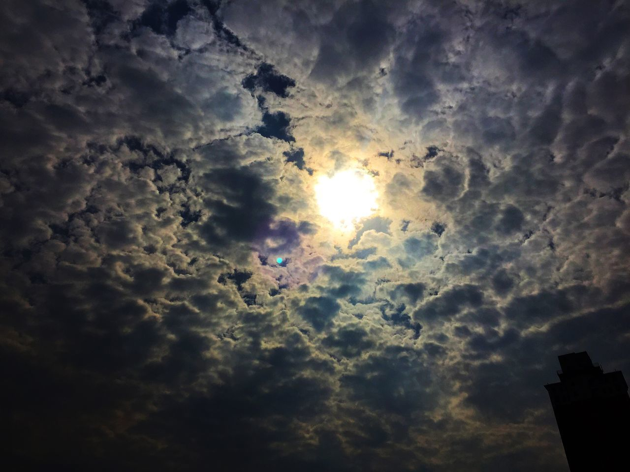 cloud - sky, sunset, sun, sky, sunbeam, silhouette, low angle view, dramatic sky, nature, sunlight, beauty in nature, outdoors, no people, storm cloud, scenics, day