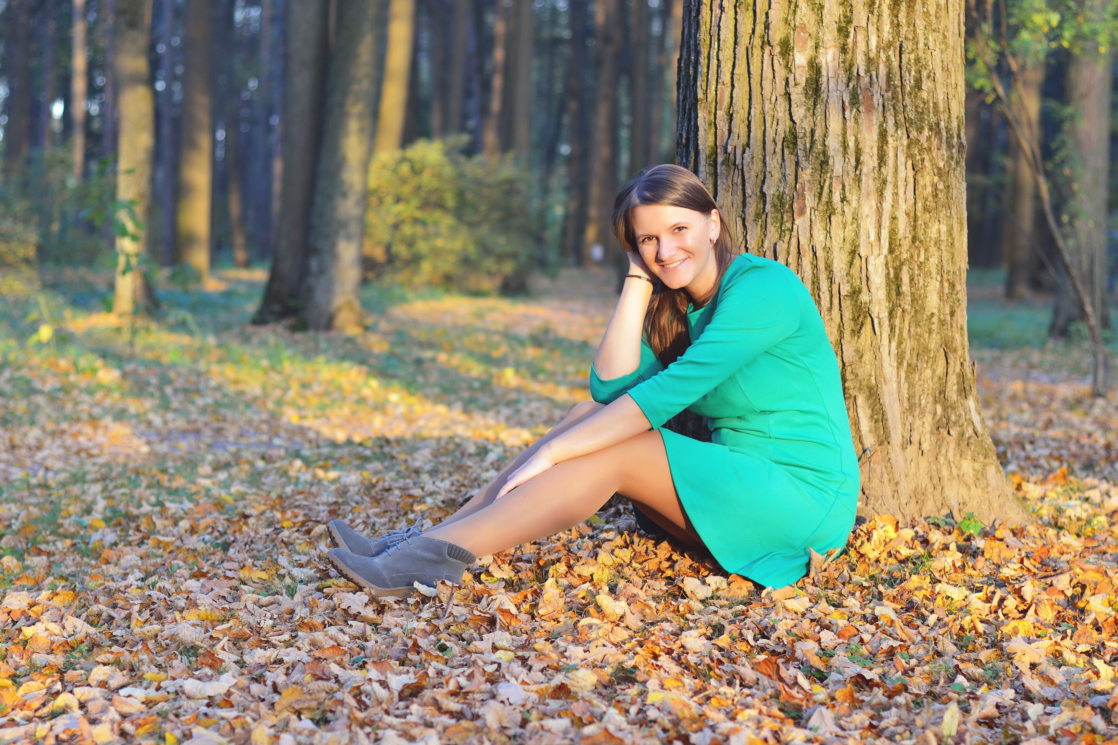 tree, lifestyles, leisure activity, forest, autumn, casual clothing, leaf, person, sitting, standing, nature, young adult, tranquility, change, season, tree trunk, full length, portrait